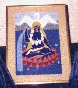 Framed painting on dark blue cloth